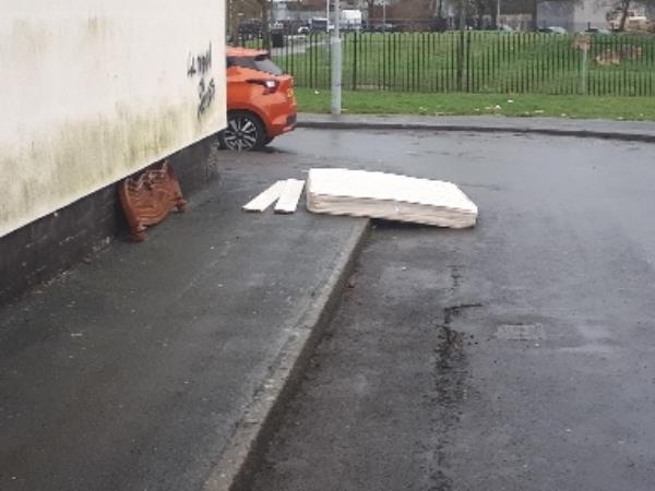 mattress and headboard dumped on footpath gower street -132 All Saints Road, Wolverhampton, WV2 1DX