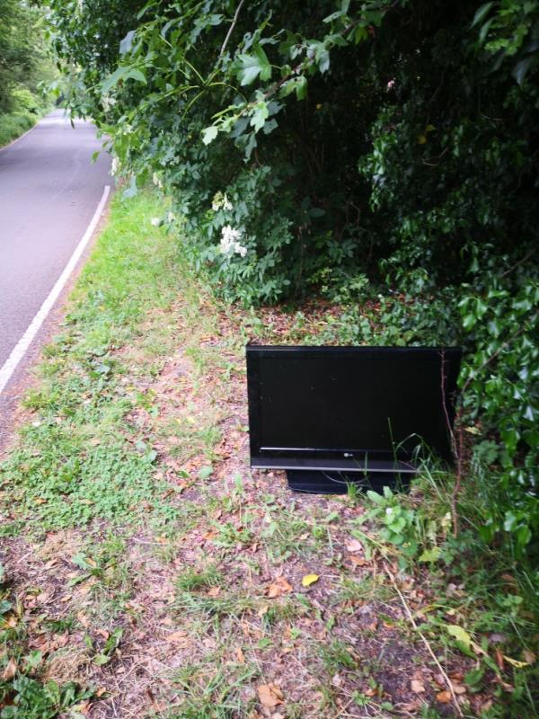 TV left at side of road-