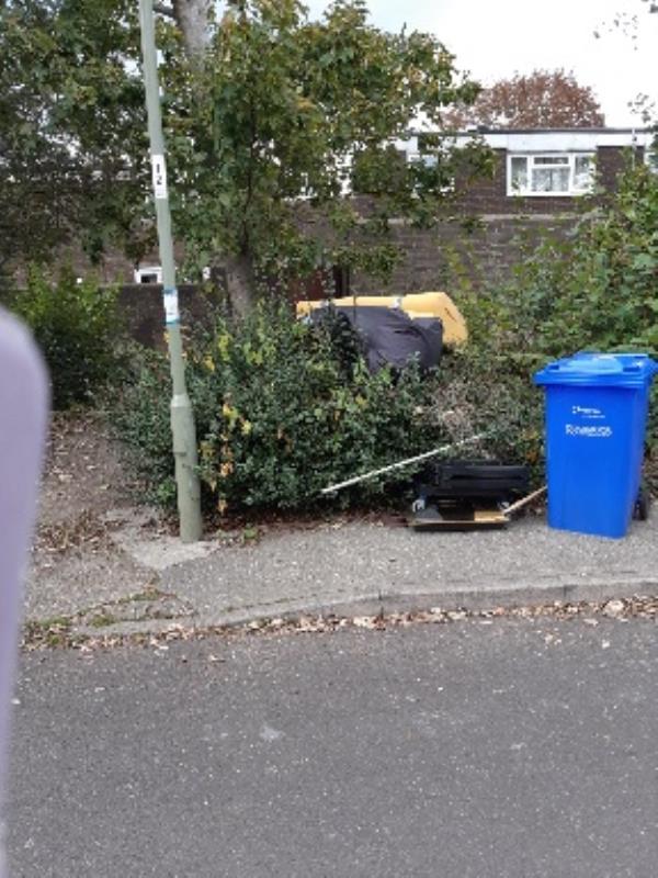 Various rubbish dumped opposite garage 101 on Austen Rd -72 Austen Road, Farnborough, GU14 8LF