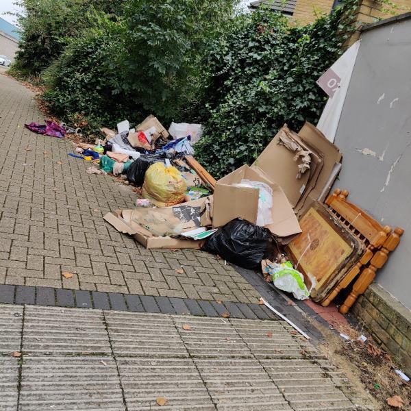 Multiple items dumped behind 1b Roman road-6A Roman Rd, London E6 3RX, UK