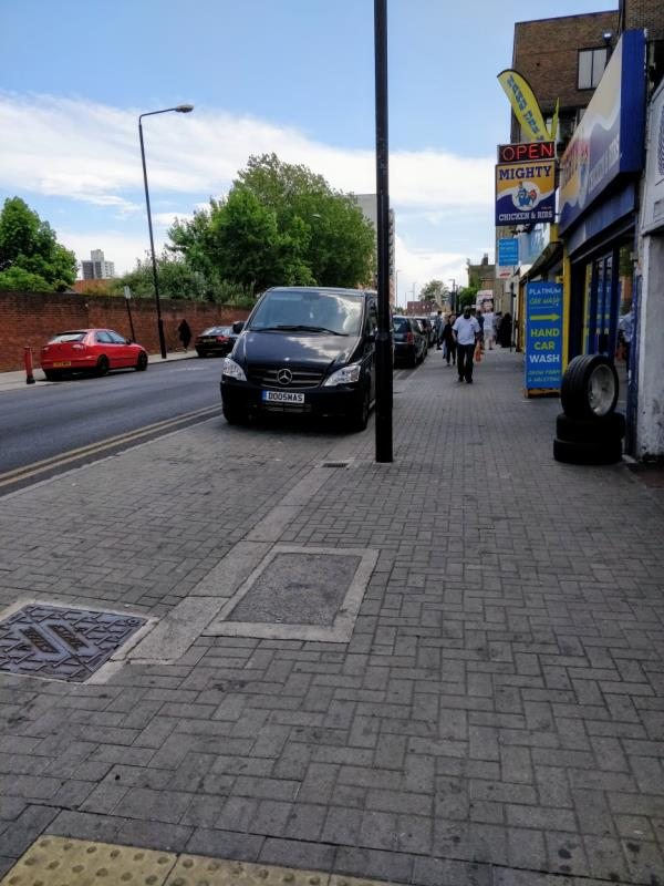 Car parked on the pavement beside 115 Leytonstone Road E15-115 Leytonstone Rd, London E15 1JA, UK