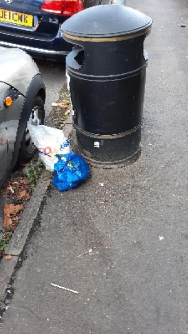 rubbish dumped besides litter bin -40 Edinburgh Road, Reading, RG30 2UA