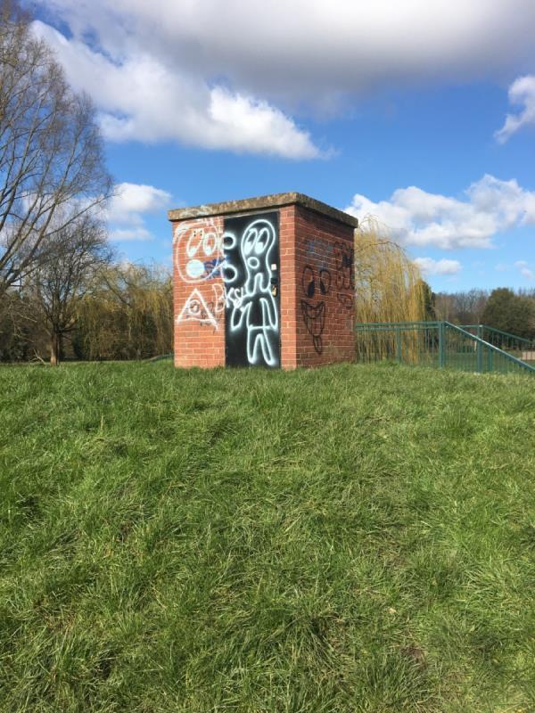Graffiti on building next to brook-53 Brighton Avenue, Wigston, LE18 1LA