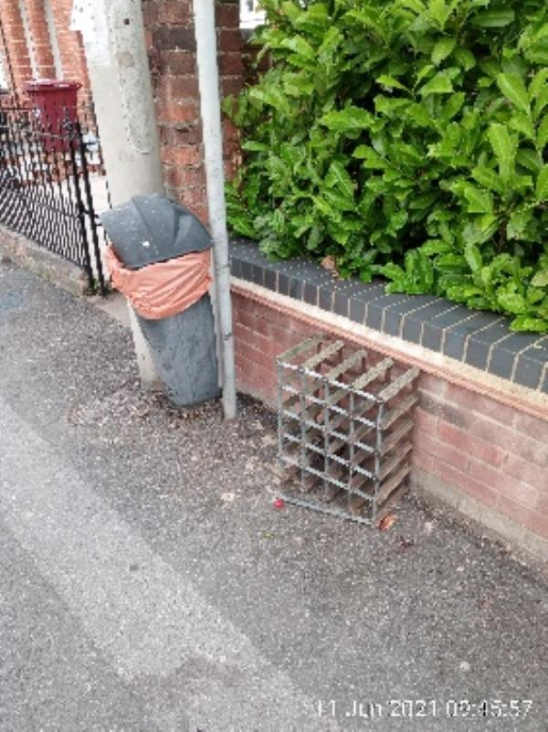 Wine rack on pavement next to litter bin. Please collect. -23 De Beauvoir Road, Reading, RG1 5NS