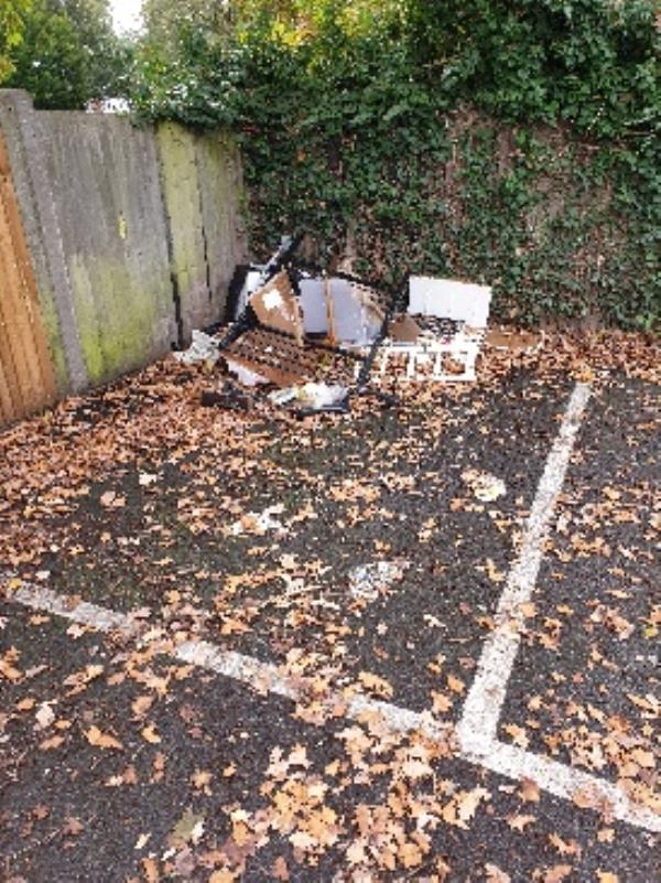 fly tipping in Farnborough Football Club car park. in the hidden corner again!-67 Robin Hood Close, Farnborough, GU14 8UD