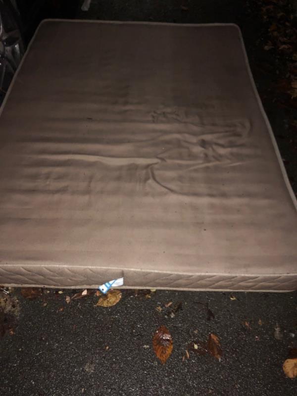 Flytipped mattress blocking pavement -27c Gurney Road, London, E15 1SH