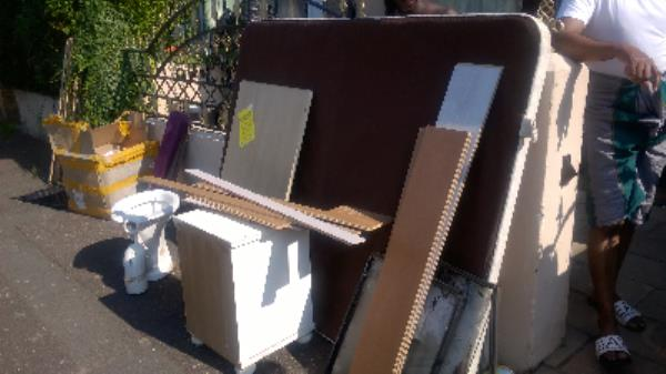Os 48 Eversham Rd E15  fly tip laminate flooring, wc pan, rug glass panes bedside unit, cardboard box, mattress panel spoke to resident not from his property items dumped while they were away-52 Amity Road, London, E15 4AT