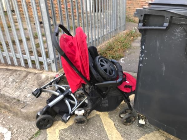 Dumped pushchair in external bin area by front entrance 42 Granville road  -40 Granville Road, Reading, RG30 3PY
