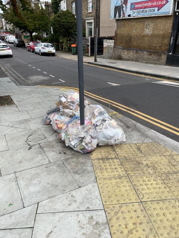 Trash on the sidewalk -1B Manbey Park Rd, London E15 1EY, UK