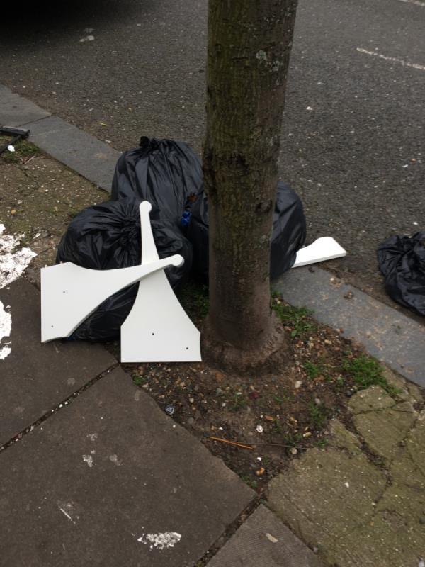 3x Black sacks opposite number nine Poynton Road N 17-13 Poynton Road, Tottenham, N17 9SH