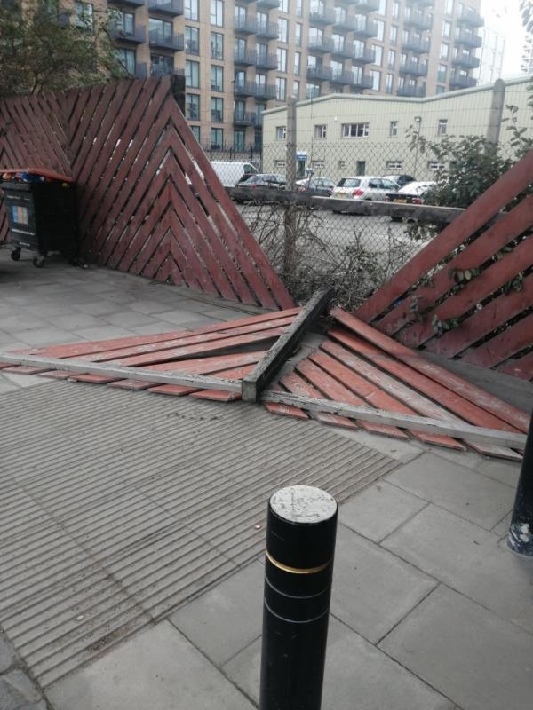 The fence in front of M&J seafood on North Woolwich Road has fallen onto the pavement due to the recent high winds. Another part of the fence is leaning and it looks like it's going to fall soon. The pavement there is used by a lot of families with children who are going to and coming from school. -10 Pirie St, Royal Docks, London E16 2BL, UK