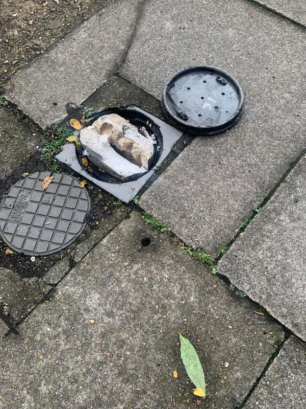 The cap of this drain has come loose and somebody has put polystyrene inside. It's very unsafe to walk past and a tripping hazard-30 Blackheath Grove, London, SE3 0DH