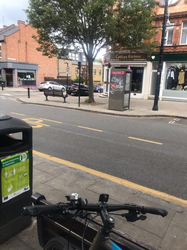Spray painted tags are located on a bt phone box on Pitshanger Lane junction Harrow View Road W5-62 Pitshanger Lane, Ealing, W5 1QX