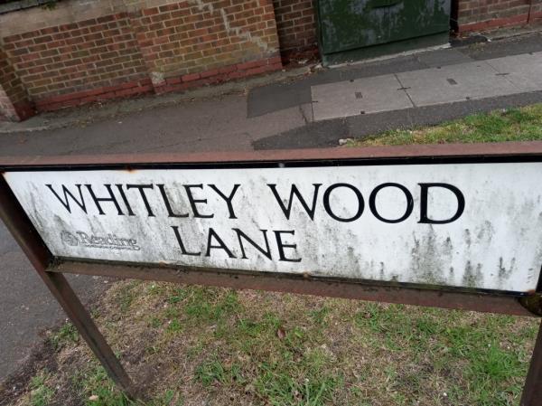Dirty street nameplate -4 Whitley Wood Lane, Reading, RG2 8PQ