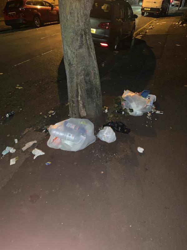 Bags of household rubbish -46 Woodhouse Grove, London E12 6SR, UK