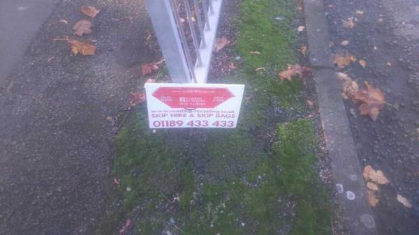 fly-poster on the railings -220 Tilehurst Road, Reading, RG30 2NE