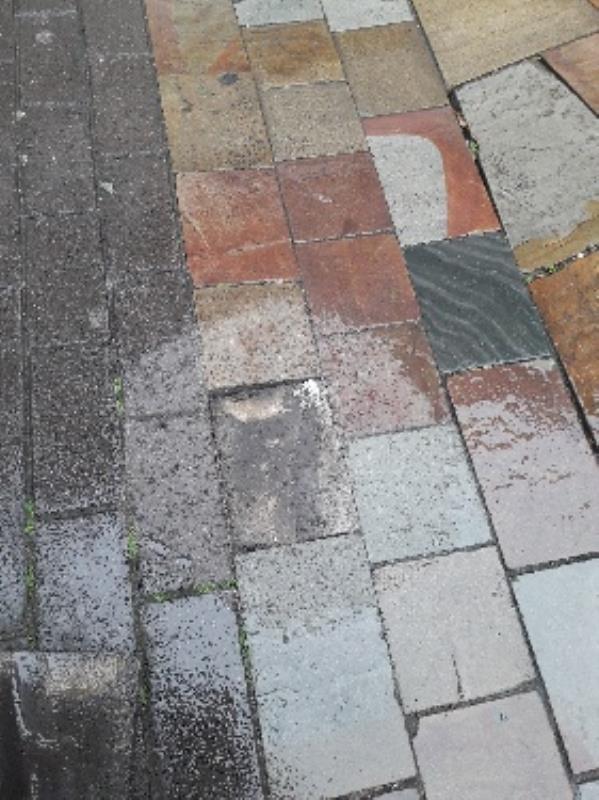 broken slab on footpath on dudley street outside thomas cook.-25 Dudley St, Wolverhampton WV1 3EY, UK