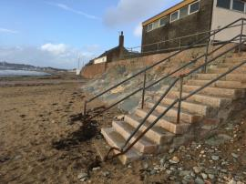 Broken/badly damaged handrail on steps leading down to La Mare beach  image 1-Public Toilet La Mare Slipway, La Grande Route de la Côte, St. Clement, Jersey,