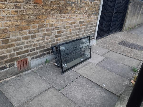 Glass table dumped on pavement close to junction with Grangewood Street -2 Friar's Road, East Ham, E6 1LH