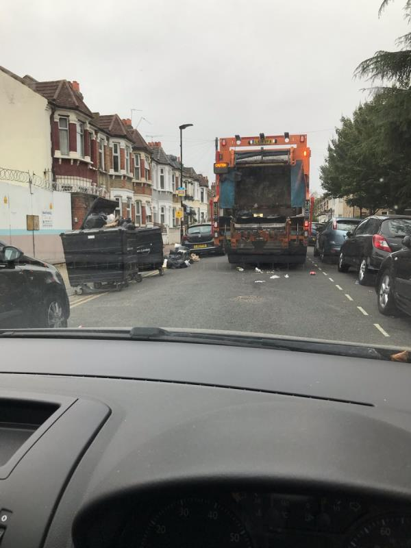 Refuse lorry only emptied 2 of 3 bins - left litter strewn all over the road and bags piled up on kerbside.-1 Saint Bartholomew's Road, East Ham, E6 3AG