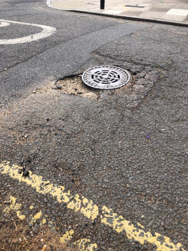 Sewer cover tarmac badly broken-39 Gunnersbury Crescent, Acton, W3 9BA