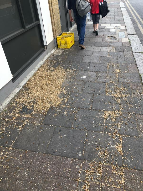 Rubbish round corner but also gravel All over pavement-296 Plashet Grove, London, E6 1DG