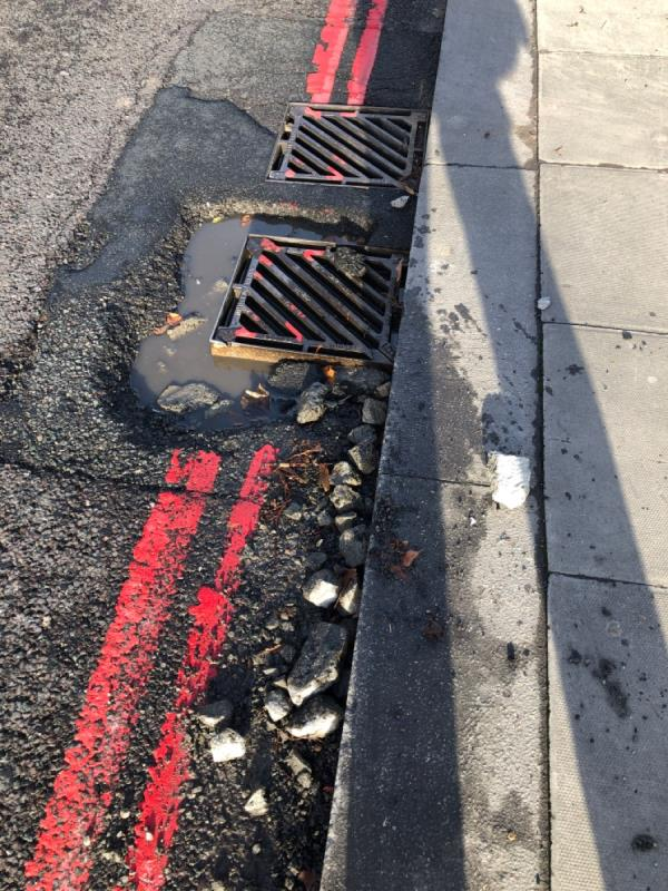 Collapsing gulley cover by Tottenham Green East South side-1 Tottenham Green East, London, N15 4DQ