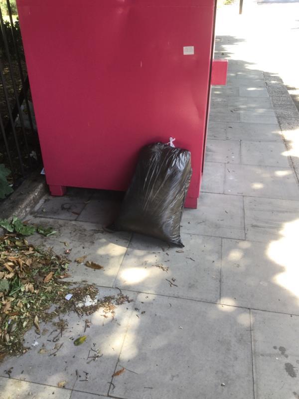 Textile fly tip next to recycling bins outside park -284 Plashet Grove, London, E7 8QU