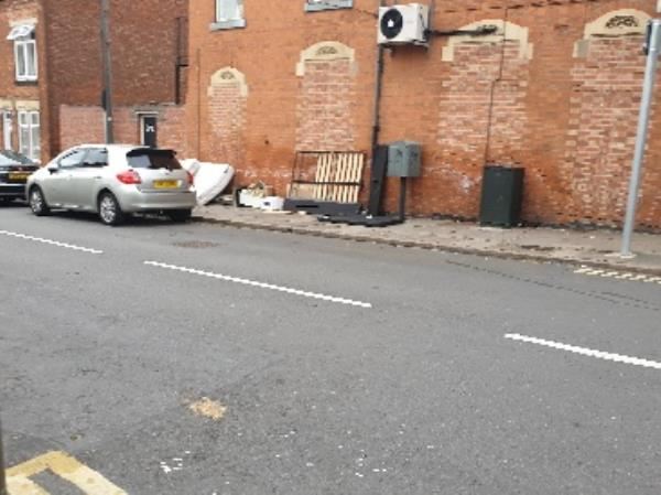 lots of Matresses thrown out of the flat located on Humberstone road and other rubbish -15 Farringdon Street, Leicester, LE5 0EB
