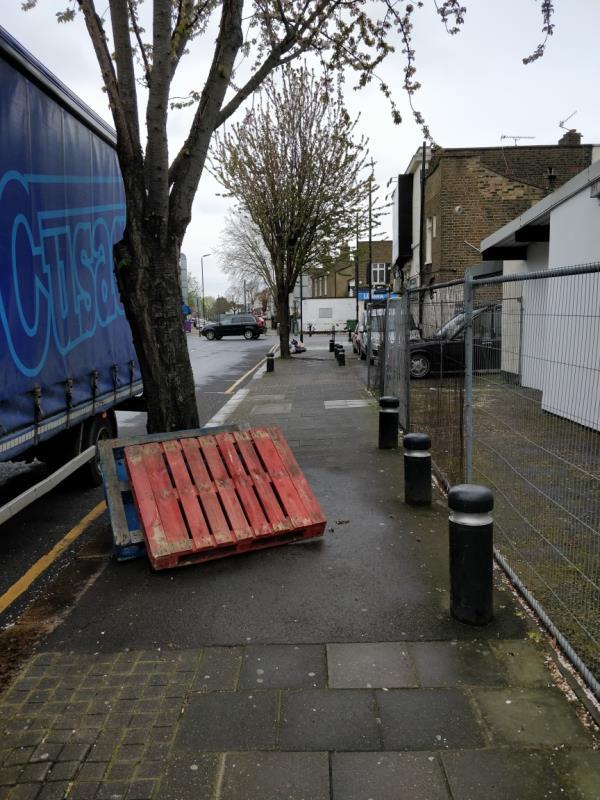 Dumped pallets on the pavement beside 1 Chobham Road E15-6 Chobham Rd, London E15 1LU, UK