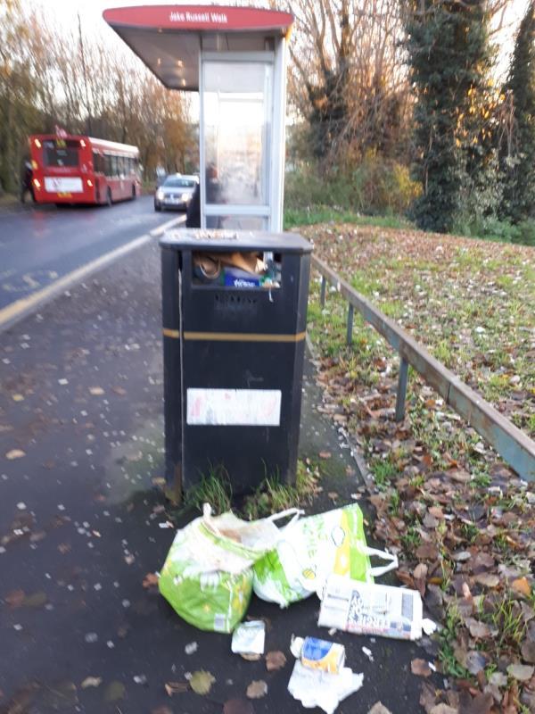 Litter bin overflowing at Bus Sop  BJake Russell Walk EI6 (Stansfeld Road)-1 Stansfeld Road, London, E6 5QJ