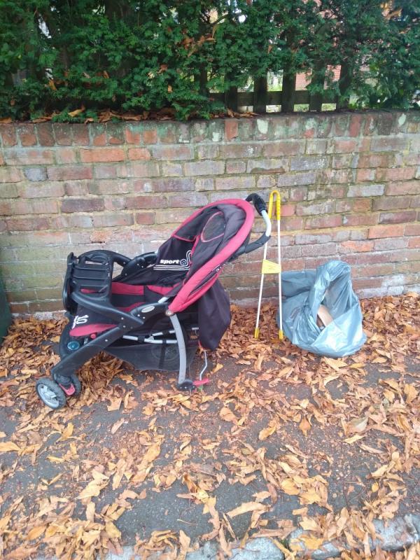 Flytipped pushchair with broken wheel no evidence taken away -43 Upper Redlands Road, Reading, RG1 5JE
