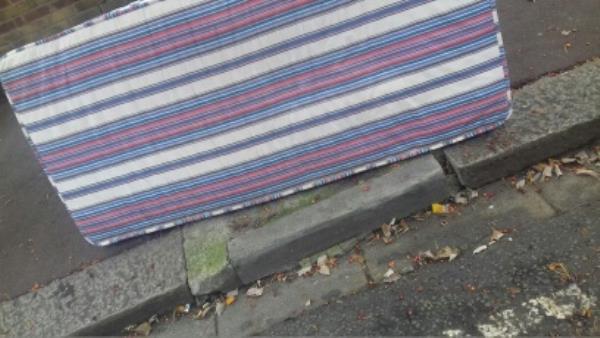 A mattress dumped outside 18 Credon Road -3 Pasteur Terrace Credon Road, London, E13 9BH