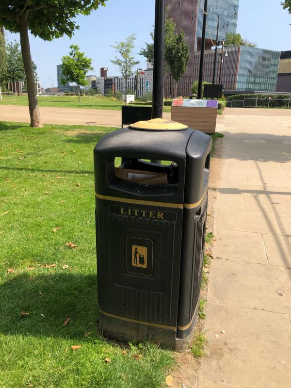 Bin full next to grass area near to lá gelateria-1 W Park Walk, East Village, London E20 1DH, UK