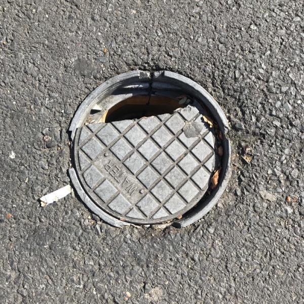 Smashed manhole cover-494-496 Katherine Road, London, E7 8DP