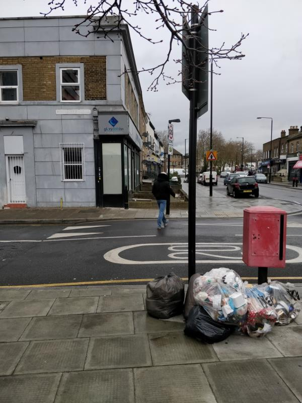 Black bags of rubbish on the pavement at the corner of Henniker Road and Leytonstone Road E15-60a Leytonstone Road, London, E15 1JY