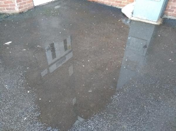 Water pooling on pavement -27 Southey Close, Leicester, LE4 6DT