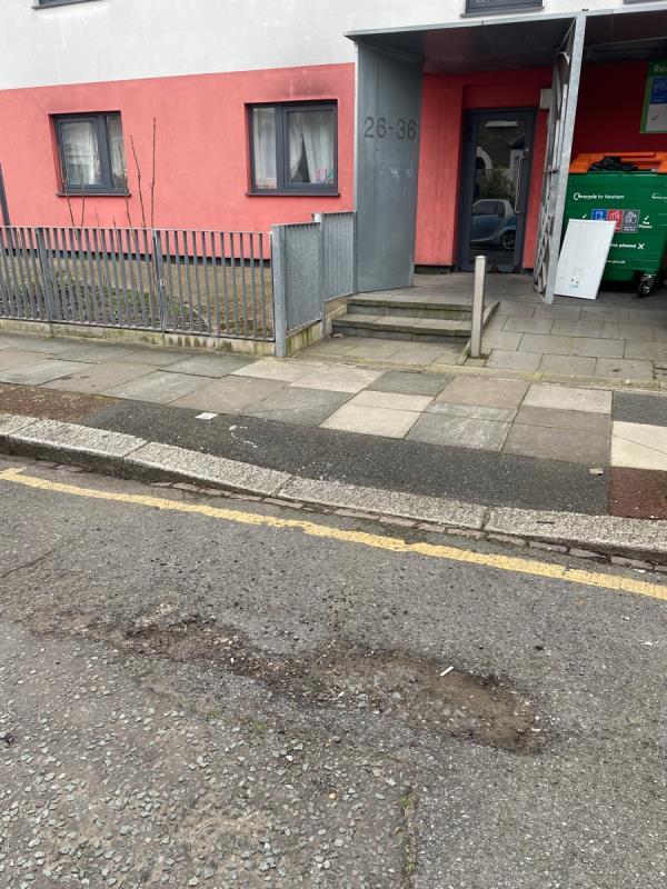 Pothole outside 26 park road flats -32 Park Road, London, E15 3QP