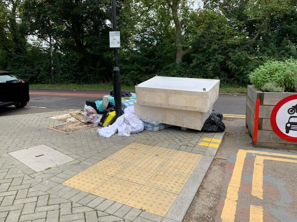 Divan bed and further rubbish added to already large tip of mattresses, rugs and bin bags on corner of Forest/Woodford Roads near the LTN planter. The longer you leave it, the more that others are encouraged to dump there too. This corner requires CCTV, as it's now known that rubbish can be dumped without punishment.-97 Woodford Rd, London E7 0DL, UK