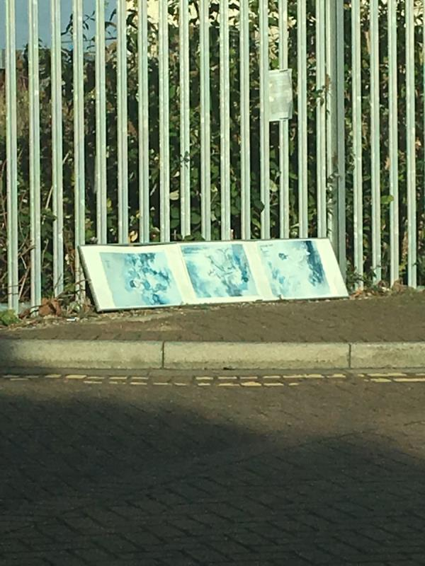 Dumped picture. Against the railing around Millennium Mills by the roundabout with a chimney.   -21 Rayleigh Road, London, E16 1UR
