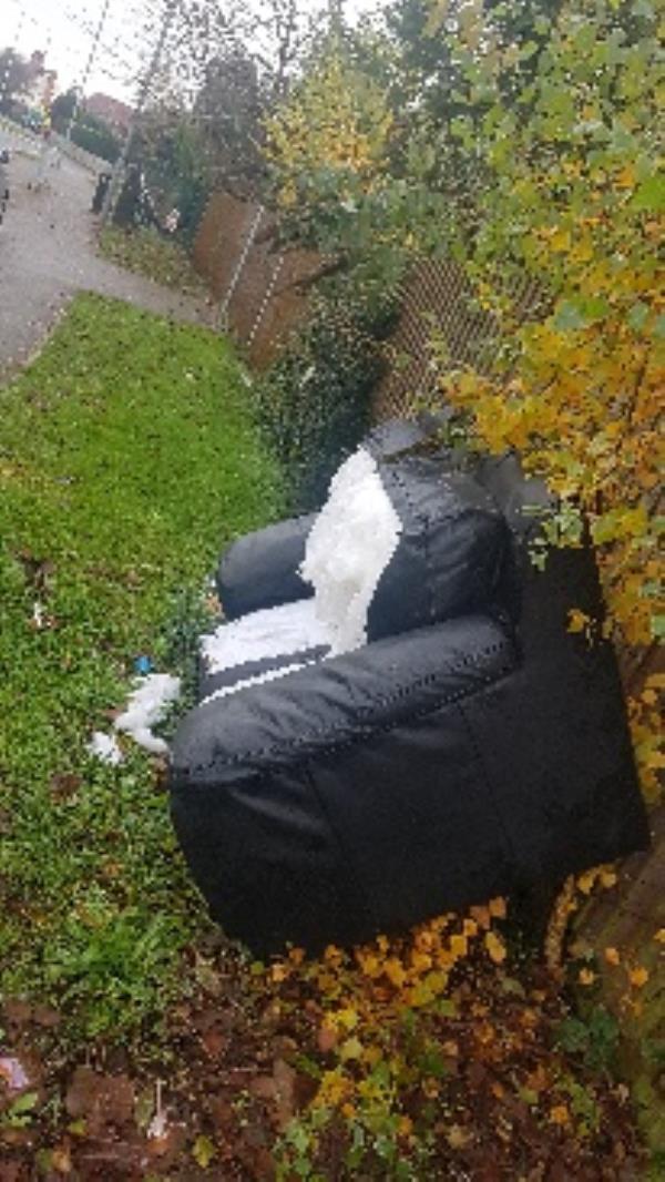 Settee dumped in Primrose Lane outside back entrance to Fallings Park Primary School.-8 New Road, Wolverhampton, WV10 8PU