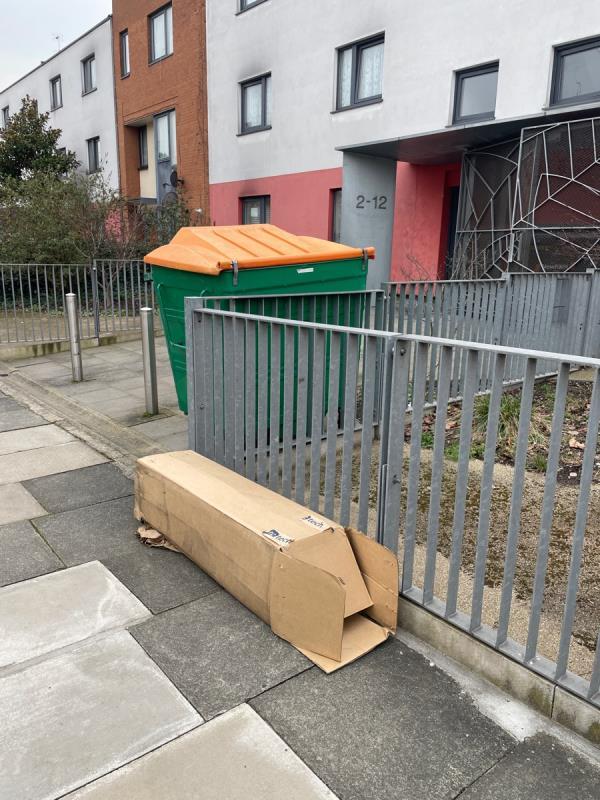 Dumped box of rubbish on public highway pavement outside flats of 2-12 park road. -2c Park Road, London, E15 3QP