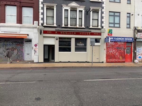 Remove graffiti from shutter-497 new cross road