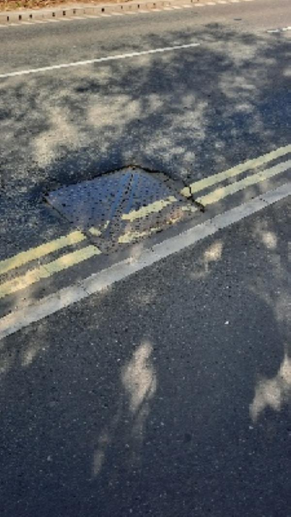 damaged man hole cover in road-Jarvis Fastline Ltd Cow Lane, Reading, RG1 8NA