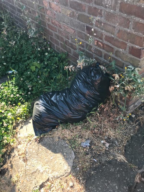Black bags dumped outside garage doors-76 Latimer Road, London, E7 0LN