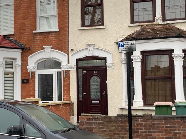 Black spray paint on parking sign-86 Brampton Rd, London E6 3LA, UK