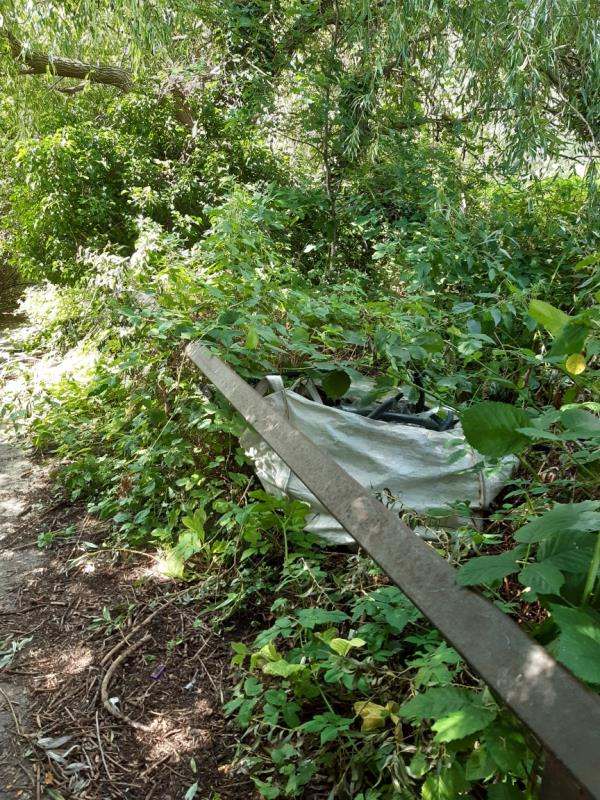Rubbish left on side of path to Waterloo meadows-Chancery Gate Business Centre Cradock Road, Reading, RG2 0AH