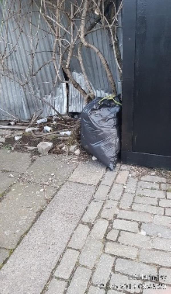 bag of rubbish opposite Kimberley gardens on Cleveland gardens-83a Kimberley Gardens, London, N4 1