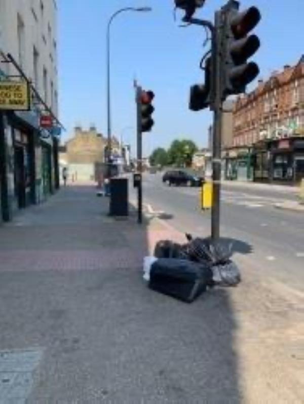 By Londis. Please clear flytip of bags-154 Lee High Road, London, SE13 5PR