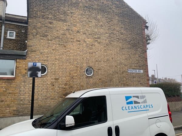 Black spray paint on parking sign-126 Frinton Rd, London E6 3HF, UK